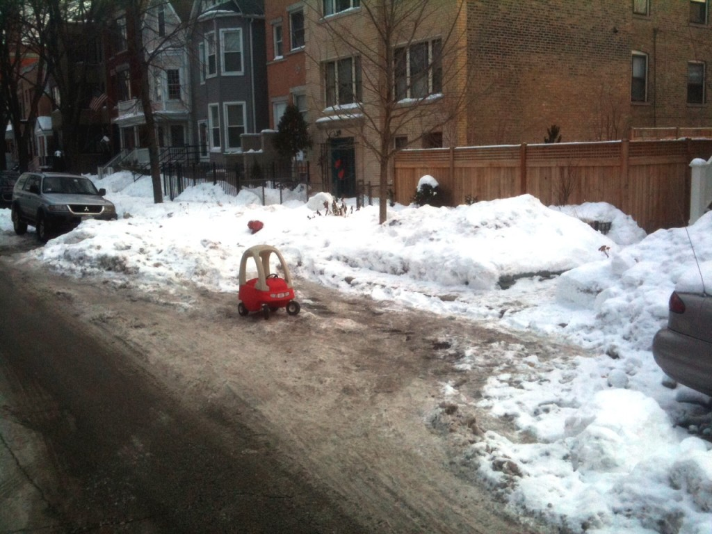 Toy car in a snowed in parking spot